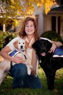 Cheryl Tipton, here with Cezanne (yellow Labrador/Golden Retriever mix) and Padriag (black Labrador), trains service dogs for Blue Ridge Assistance Dogs.