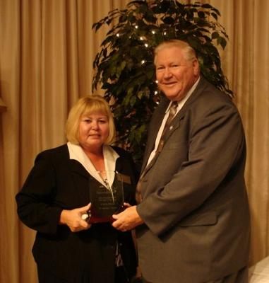 Connie Moser shares the news of her award with Neabsco District Supervisor John Jenkins