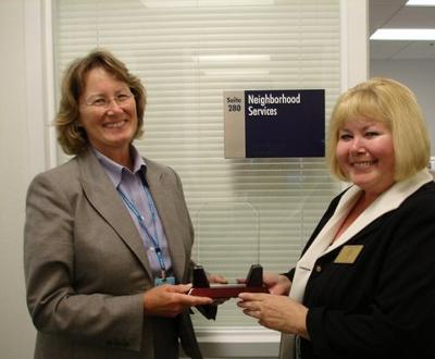 Connie shares the news of her award with Pat Reilly, Director of Prince William County's Neighborhood Services Division